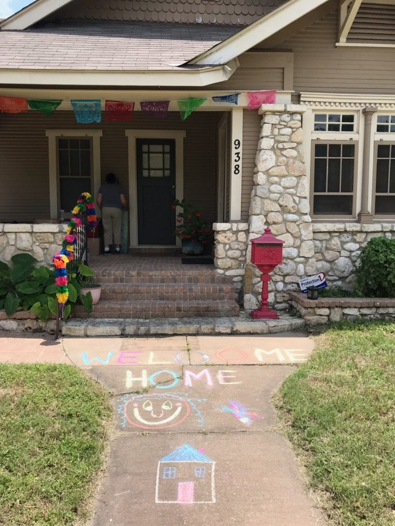 Welcome Home Chalk Drawing in Front of House